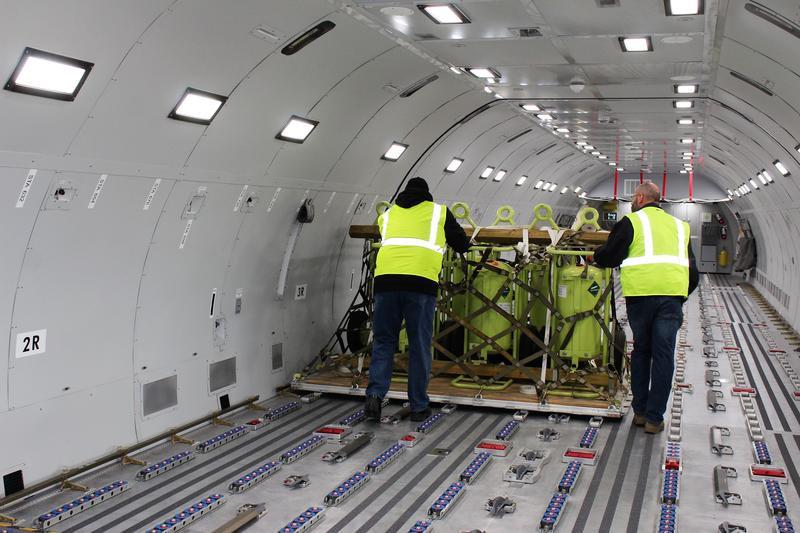 A crew loads a pallet of supplies into a KC-46 fuselage training replica at McConnell Air Force Base.