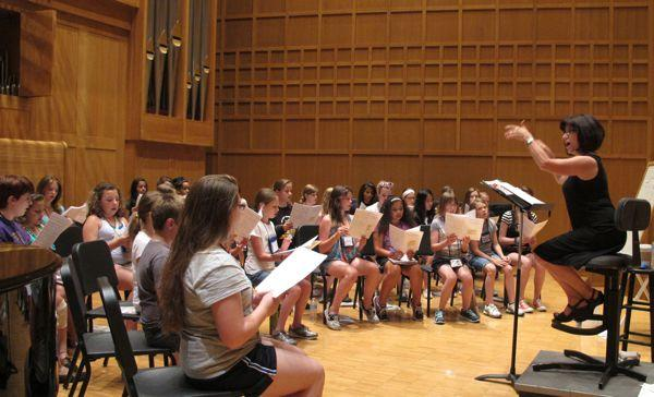 laine Quilichini conducts the WSU Kodaly Children's Choir during a rehearsal.