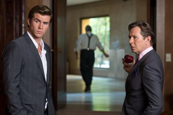 In this high-stakes thriller, Liam Hemsworth, left, is a regular guy trying to get ahead in his entry-level job.