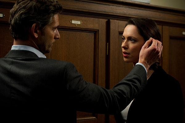Eric Bana looks for secrets behind Rebecca Hall's ear in 'Closed Circuit'