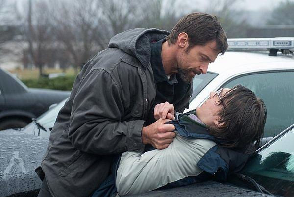 Hugh Jackman, brutally restrained in his treatment of Paul Dano, in 'Prisoners'