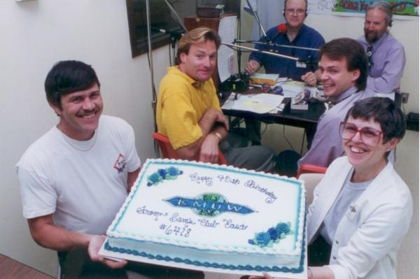 From 1994: News Director Gordon Bassham, General Manager Mark McCain, KWCH's Roger Cornish and two employees from Sam's Club join Pat Hayes in celebrating KMUW's 45th birthday.