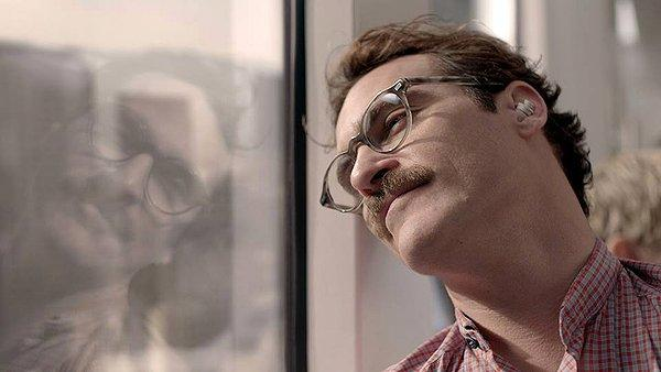 Joaquin Phoenix gets to know Scarlett Johansson (that's her in his ear) in 'Her'
