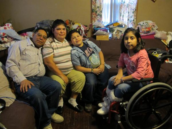Felipe, Maria, Jesus and Luz Rodriguez.  Felipe's family is  faced with ongoing medical issues. He finds himself in the Medicaid gap.