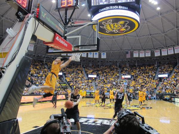 WSU's Ron Baker breaks past Southern Illinois players on Feb. 11, dunks