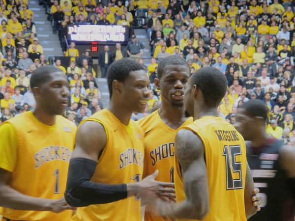 Shocker players huddle up after a play during the Feb. 11 game against Southern Illinois. WSU defeated the Salukis 78-67.