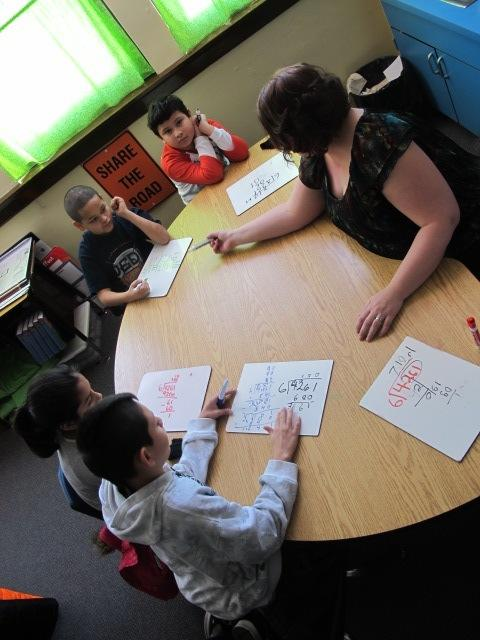 Granell's fourth graders are practicing improper fractions problems as part of the lesson plan aligned with Common Core goals.