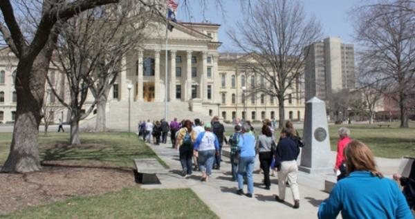 Education advocates walk to the Kansas Statehouse for a ceremonial end to the trip.