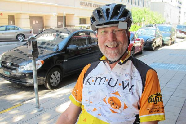 Larry Bennett rides his recumbent bike to a KMUW event at Anna Murdoc's.