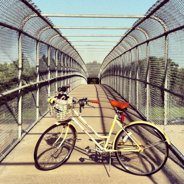 Amy's beloved yellow Huffy on one of Wichita's elevated walking paths.