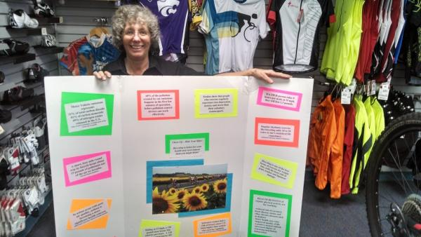 Bicycle Pedaler Ruth Holliday shows off a poster of bicycle benefits and facts that she often takes to school presentations.