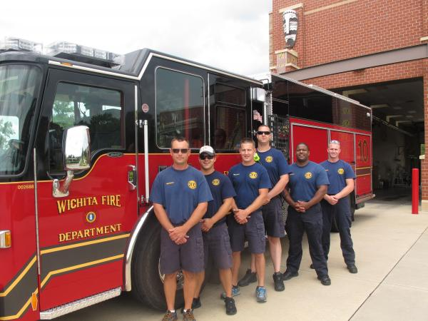 Acting Lieutenant, Michael Ring, Firefighter, John Haltrup, Josh Roberts, Jermiah Toothaker, Captain Mark Jordon, Firefighter Clint Goode stand by new fire engine at Wichita Fire Department Station 10.