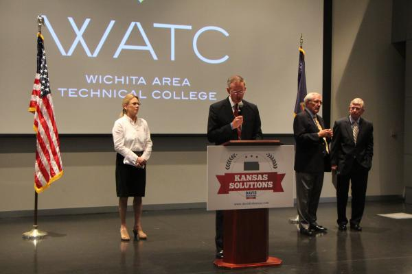 Kansas gubernatorial candidate Paul Davis speaks at Wichita Area Technical College. Alongside him are running mate Jill Docking and newly appointed economic advisors Gary Sherrer, far right, and John Moore.