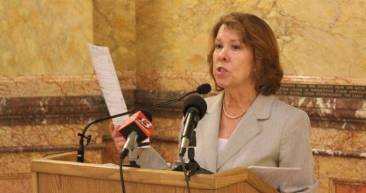 Jean Schodorf holds a voter registration form during a news conference at the Kansas Statehouse.