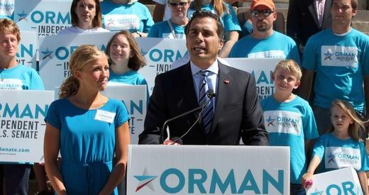 Orman speaking at an event at the Kansas Statehouse.