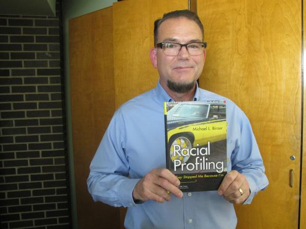 "Wichita State University Professor, Michael Birzer, with his book, ""Racial Profiling: They Stopped Me Because I'm _________"""