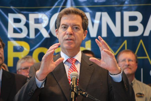 Kansas Governor Sam Brownback speaking at Wichita Area Technical College on Tuesday, Aug. 12.