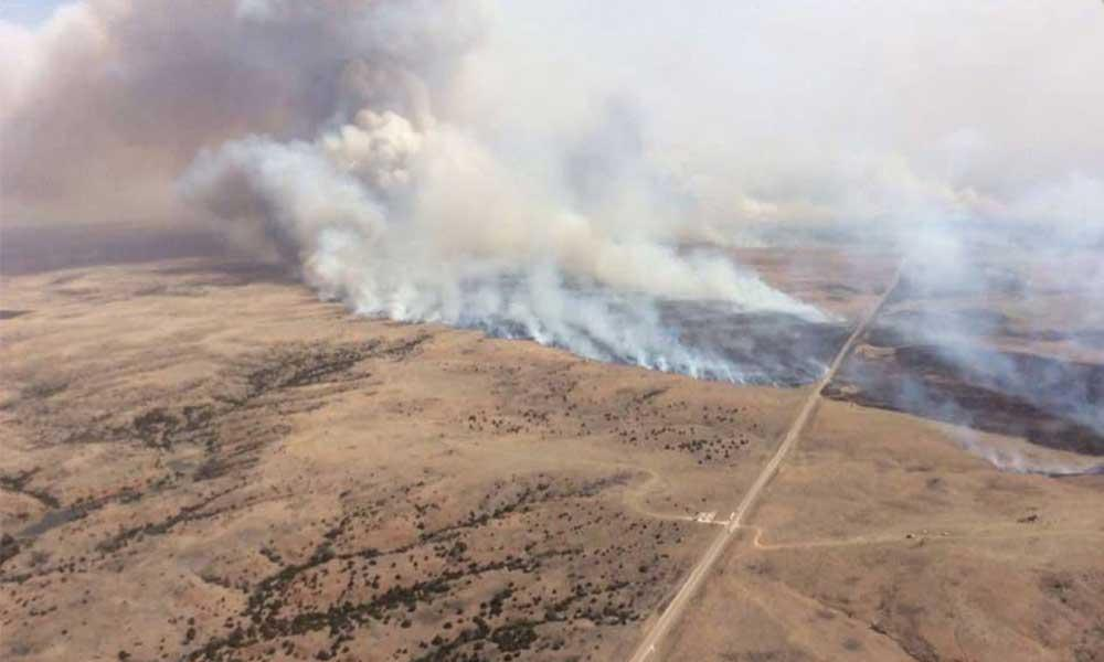 Uncontrolled wildfires burn in Kansas, Oklahoma
