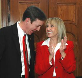 Gov. Jan Brewer and Secretary of State Ken Bennett, the man who says she can't run again in 2014, from a 2009 photo after both got their new offices following the resignation of Janet Napolitano.