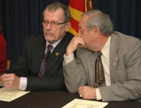 AZ GOP Chairman Tom Morrissey and John Rhodes, sign Electoral College papers casting their vote for Mitt Romney. Both men said they have doubts about President Obama's birth certificate and his right to serve