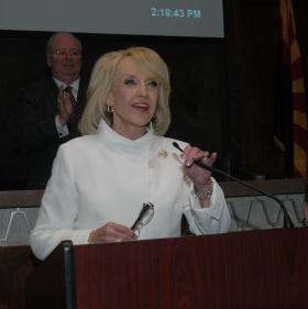 Gov. Jan Brewer addresses the Arizona Legislature for the annual State of the State speech. Behind her is House Speaker Andy Tobin.