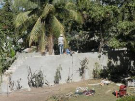 Flagstaff volunteers reconstruct a containment wall at an orphanage near Port au Prince, Haiti
