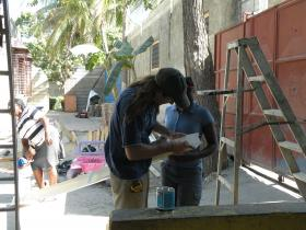Flagstaff contractor Alex Helwig gives a lesson in hanging gutters. Bon Repos, Haiti