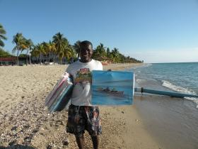 Joshua, an artist, sells his paintings at The Indigo Beach Resort, Haiti