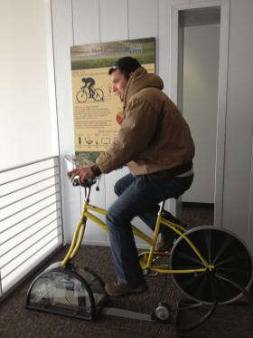 "An NAU student ""powers up"" personal electronics on the eco-pedaler"