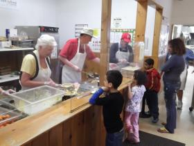 Volunteers serve up dinner at the Flagstaff Family Food Center