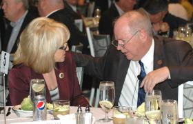 Gov. Jan Brewer and House Speaker Andy Tobin chat at a luncheon Friday. Brewer gives what is likely her final State of the State speech on Monday in the House chambers.
