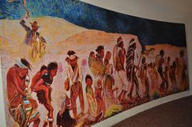 Shonto Begay's large mural commemorating the Long Walk hangs in Ft. Sumner, N.M.