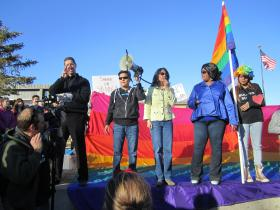 Addressing the crowd (from second from left): Kathryn Jim, president of Northern Arizona Pride Association; Councilwoman Celia Barotz; and Vice Mayor Coral Evans.