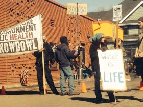 Protestors gather near San Francisco Street in downtown Flagstaff during the third annual Dew Downtown.