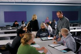 Chris Scherpereel works with students in NAU's BizBlock program.