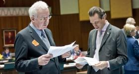 Rep. John Kavanagh, R-Fountain Hills, (left) and Rep. Steve Smith, R-Maricopa, read proposed budget amendments Thursday.