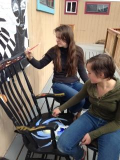 Naomi Frances, on the right, works on her celestial rocking chair.