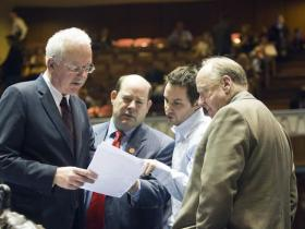 Rep. John Kavanagh (left) discusses the state budget with fellow representatives.