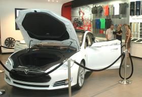 Would-be shoppers check out the all-electric Tesla at the company's Scottsdale showroom where, under current law, they cannot actually buy the vehicle. Legislation approved by a Senate panel would let the company sell directly to consumers in Arizona.