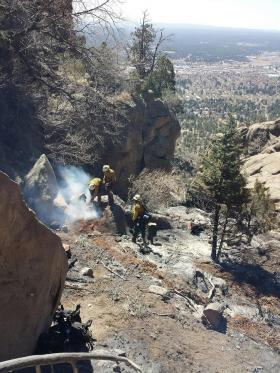 The Mesa Hotshots from the Tonto National Forest mop up a stump hole on the Boulder Fire.