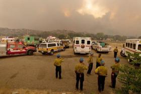 Members of the Blue Ridge Hotshots and other firefighters watch as the Yarnell Hill Fire advances, June 30, 2013.