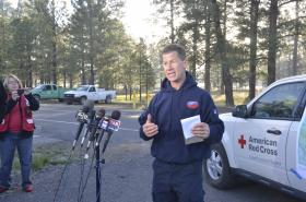Flagstaff Fire Captain Bill Morse gives an update on Thursday morning at the Ft. Tuthill staging area in Flagstaff.