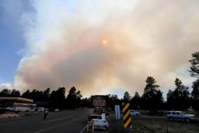The Slide Fire looms in the background as some Flagstaff residents voluntarily evacuate their homes.