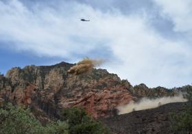A helicopter drops straw mulch on a severely burned area north of Slide Rock State Park in Oak Creek Canyon.