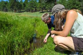 Hydrogeologist, Abe Springer and student researcher, Karissa Ramstead in the field