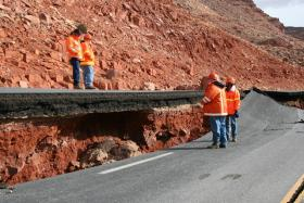 Crew members examine the collapsed section of U.S. 89A south of Page soon after the February 2013 landslide.