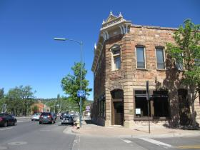 Flagstaff's old Bank Hotel, built in the 1880s, survived many fires downtown. It was one of the first non-wood buildings in Flagstaff. It's now the home of a bar and restaurant and is still owned by the descendants of the builder, Thomas McMillan.