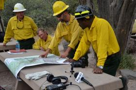 Members of the U.S. Forest Service Burned Area Emergency Response team go over a map of treatments already underway.