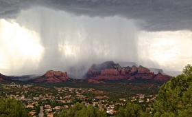 A monsoon storm opens up over the red rocks of Sedona.