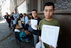 DACA applicants wait in line in Los Angeles to avoid deportation.
